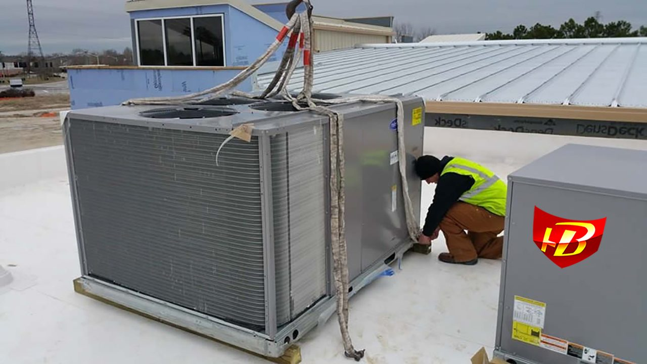Hotboys HVAC intalling a commercial air handler on roof